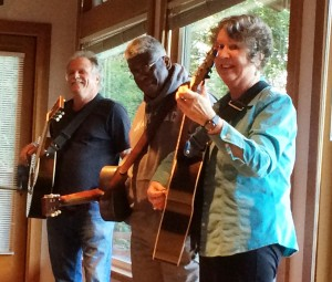 Pat Donohue, Rev. Robert Jones, and Mary Flower with guitars